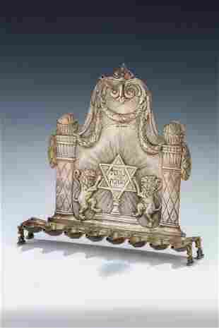 A SILVER CHANUKAH LAMP. Germany, c. 1880. The base held