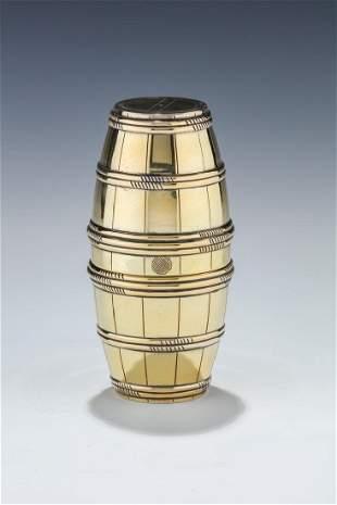 A PARCEL GILT DOUBLE BARREL SILVER CUP SET. France, c.