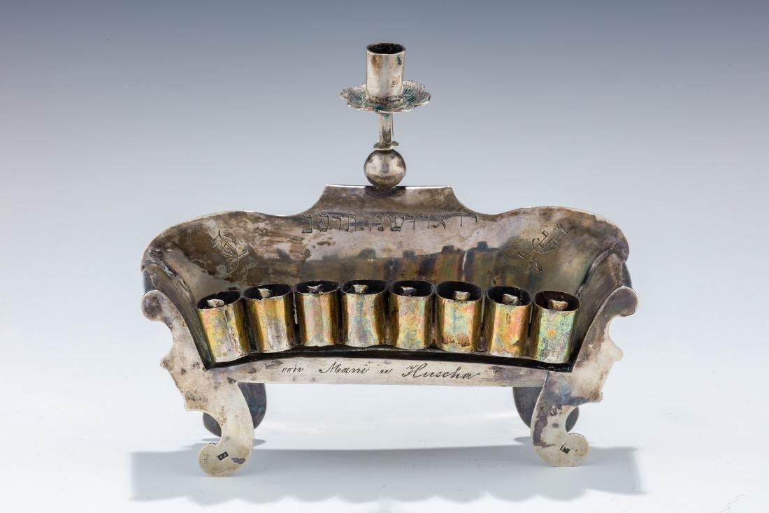 A SILVER CHANUKAH LAMP. Poland, 19th century. On four
