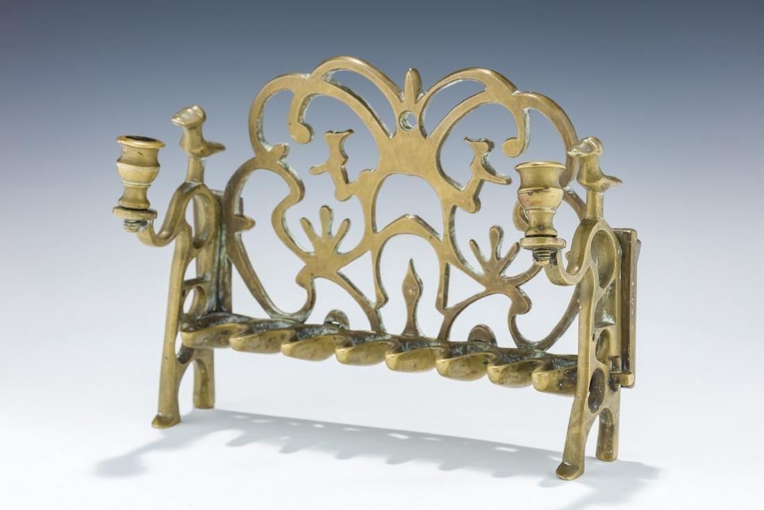 A BRASS CHANUKAH LAMP. Poland or Ukraine, 18th century.