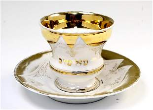 AN EARLY JUDAIC TEA CUP AND SAUCER Probably German c