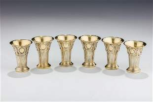 A GROUP OF SIX GILDED SILVER KIDDUSH BEAKERS BY LAZARUS