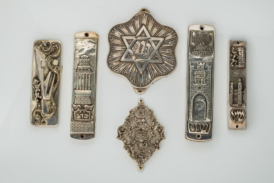 A GROUP OF SIX STERLING SILVER MEZUZOT BY HENRYK