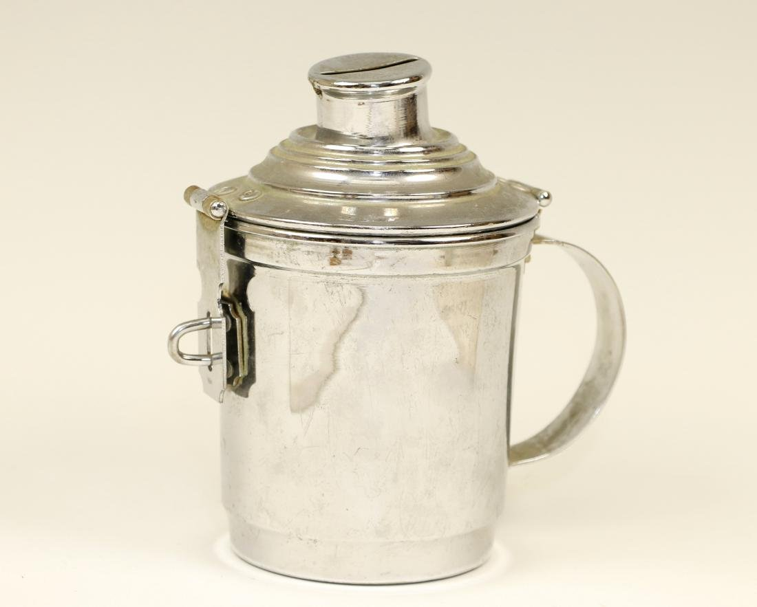 38. A CHROME CHARITY CONTAINER. Mexico, c. 1960. With