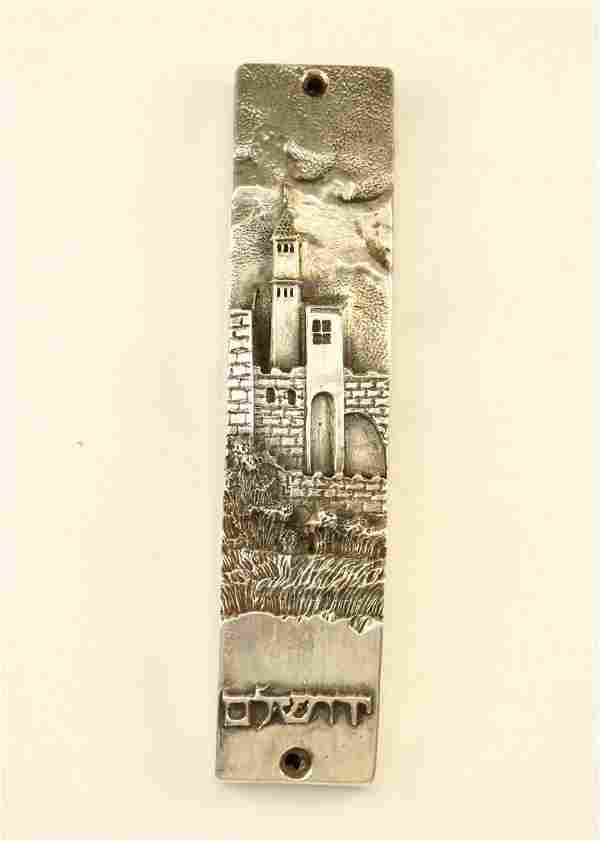 40. A STERLING SILVER MEZUZAH BY HENRYK WINOGRAD CASE.