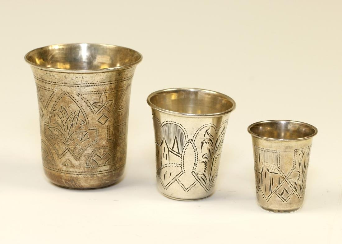 69. THREE SILVER BEAKERS. Russian, c. 1900. Engraved
