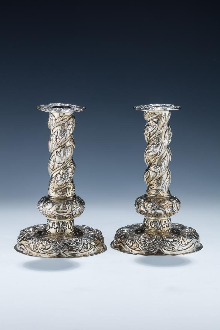 12. A PAIR OF SILVER CANDLESTICKS. Dutch, 19th century.