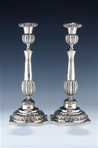 A PAIR OF EXCEPTIONAL SILVER SABBATH CANDLESTICKS BY