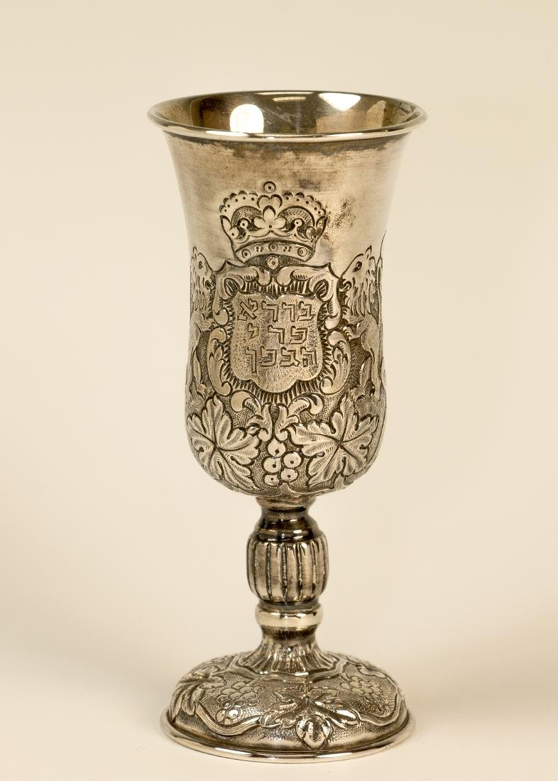 A STERLING SILVER KIDDUSH GOBLET BY WOLF HECKER.