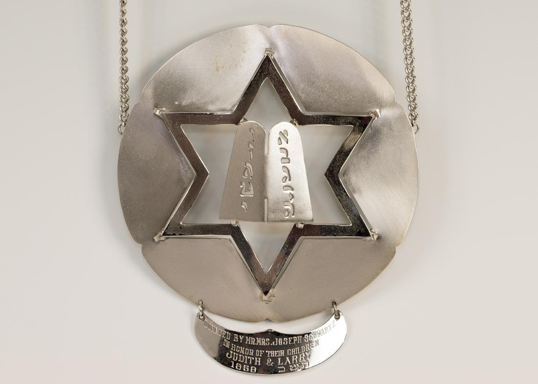 A TORAH SHIELD. Probably American, c. 1960. Round with