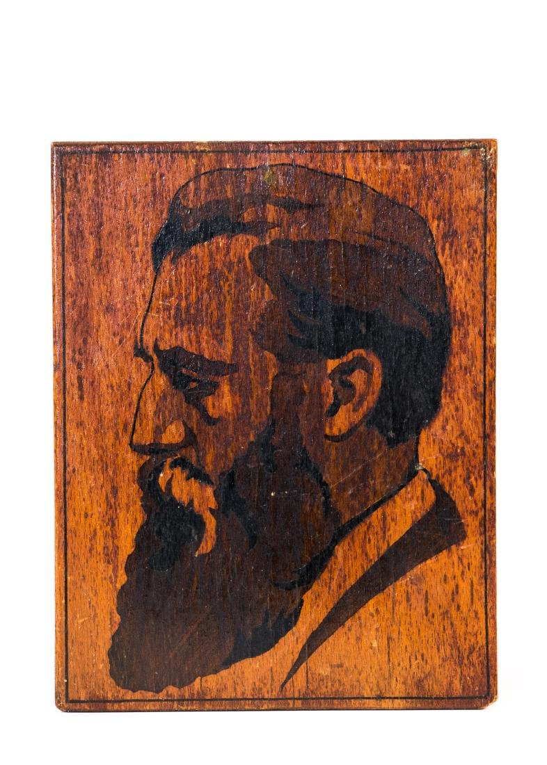 A WOOD PLAQUE WITH THE PROFILE OF THEODOR HERZL BY THE