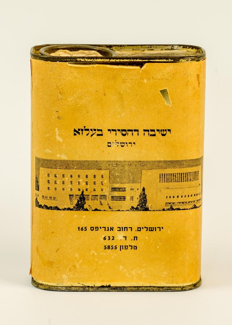 A TIN CHARITY BOX COLLECTING FUNDS FOR BELZ YESHIVA.