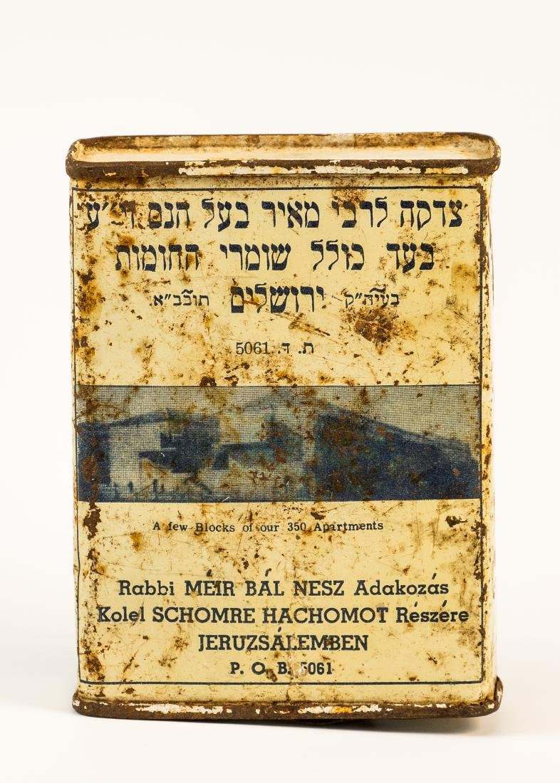 A TIN CHARITY BOX COLLECTING FUNDS FOR KOLLEL SHOMREI