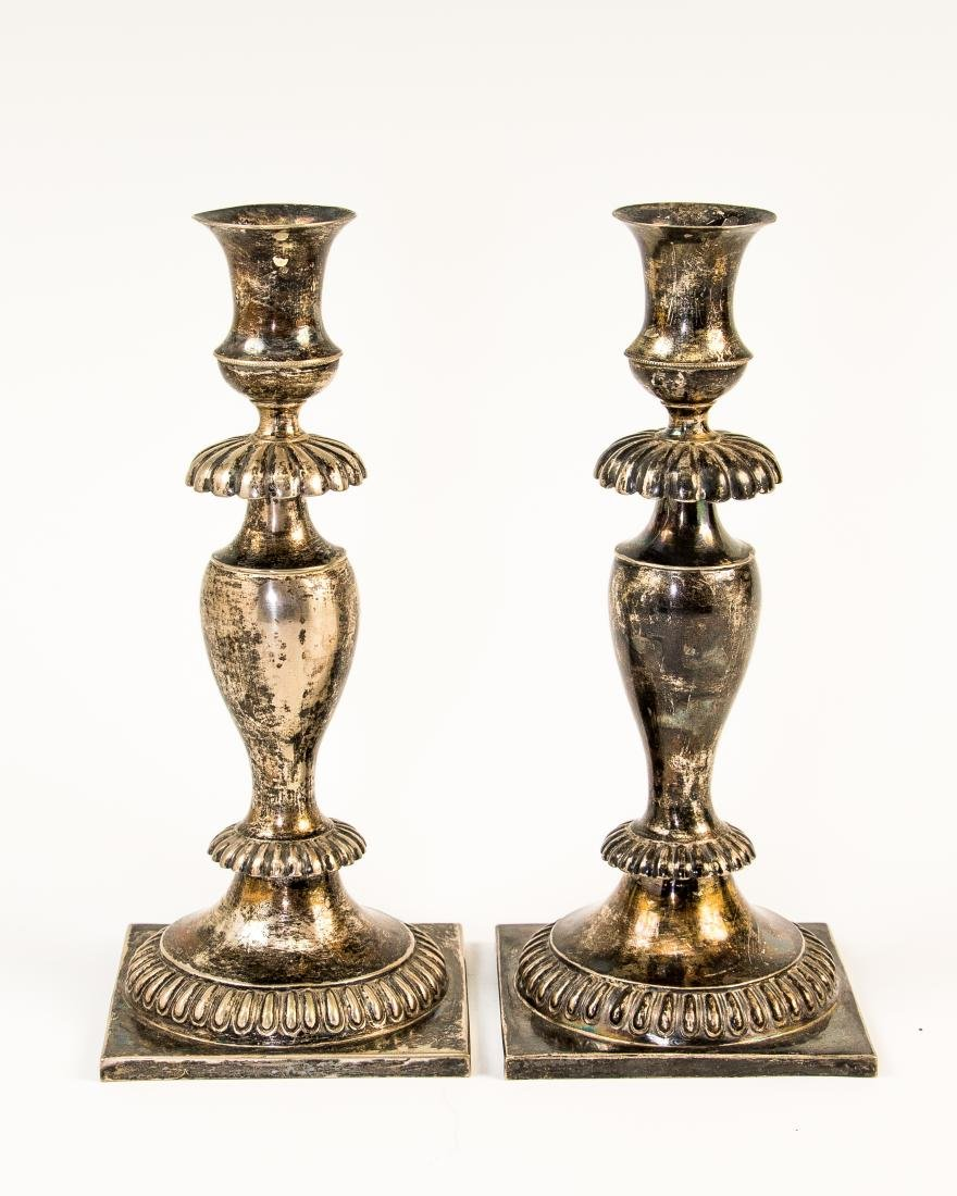 AN EARLY PAIR OF SILVER CANDLESTICKS. Poland, c. 1820.