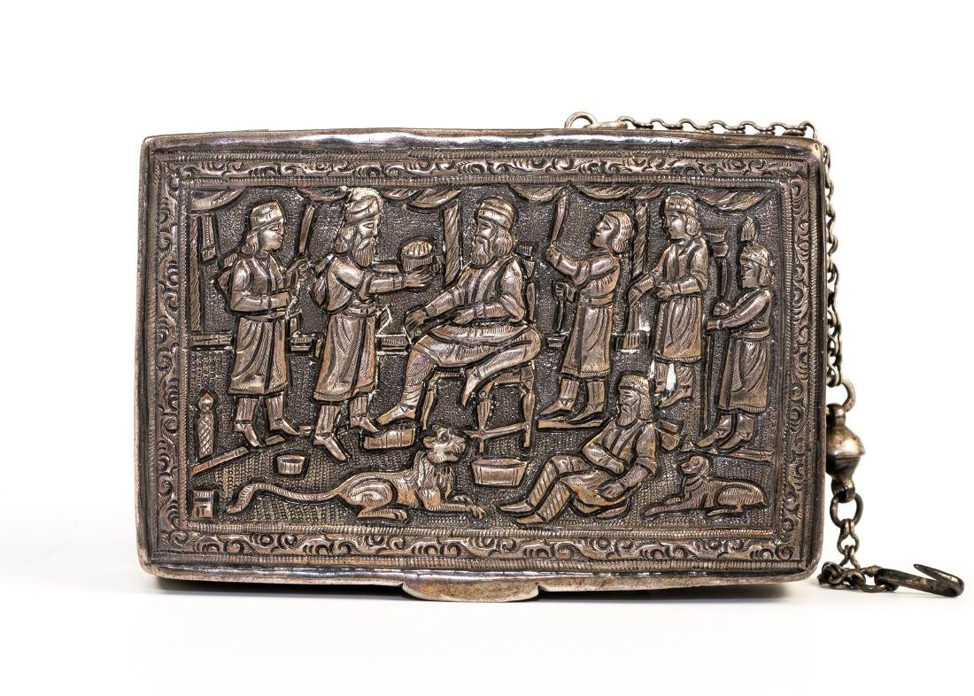 A SILVER SNUFF BOX. Possibly Persian, c. 1900. Chased