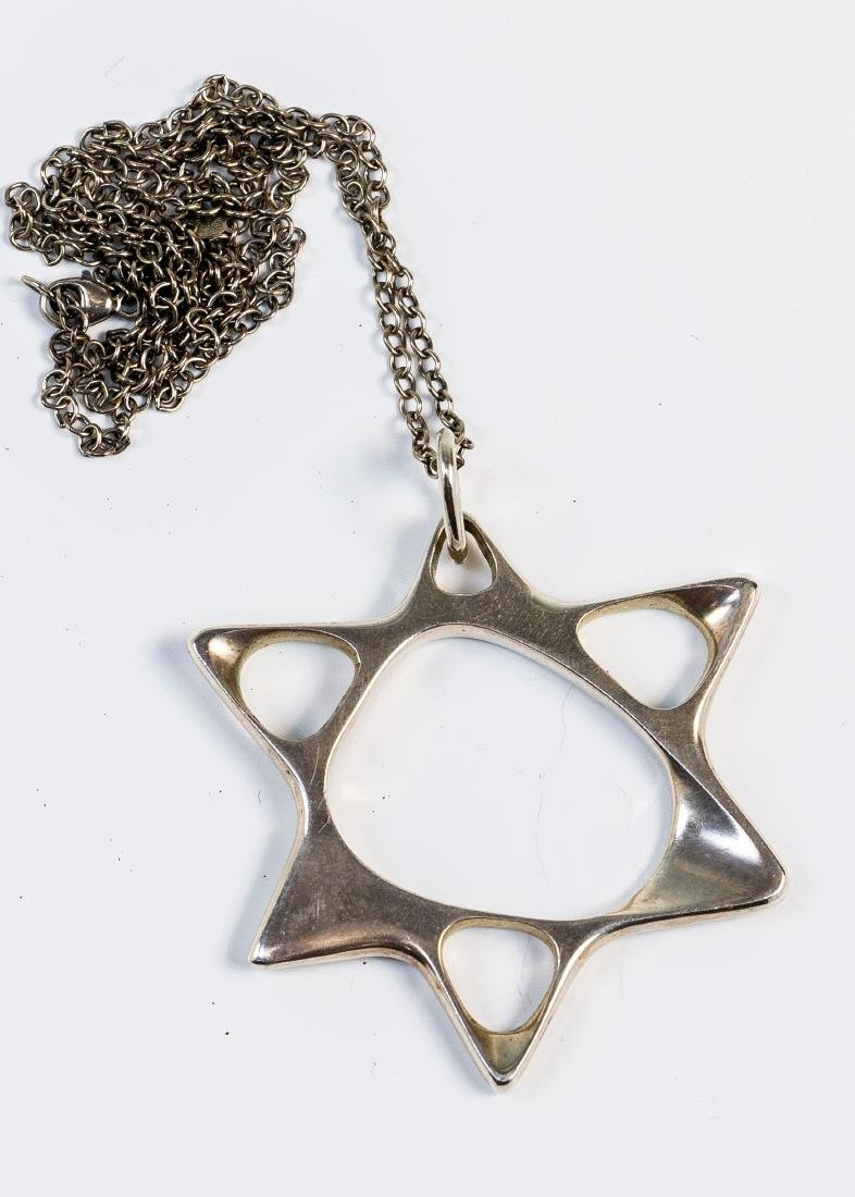 A LARGE STERLING MAGEN DAVID AND CHAIN BY GEORG JENSEN.