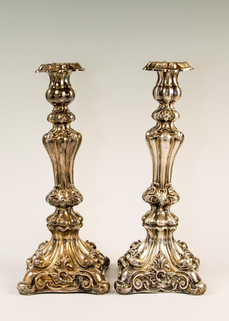 A PAIR OF SILVER CANDLESTICKS. Russian, 19th century.