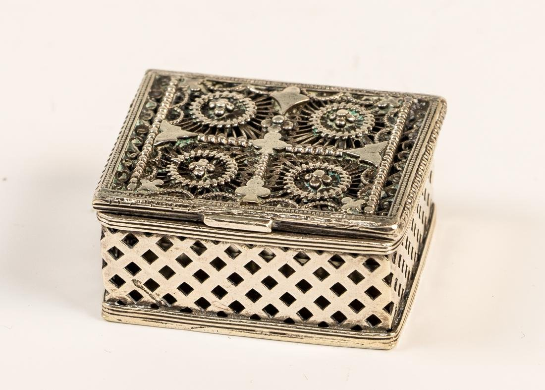 A SILVER SPICE BOX. Continental, 19th century. Square