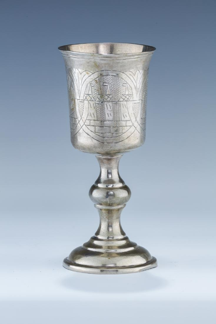 A LARGE SILVER KIDDUSH CUP. Poland, c. 1830. On a round