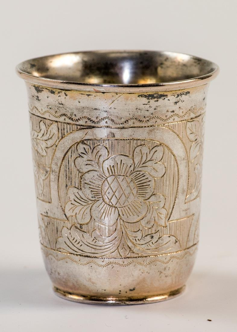 A SILVER KIDDUSH BEAKER. Poland, c. 1840. Engraved with