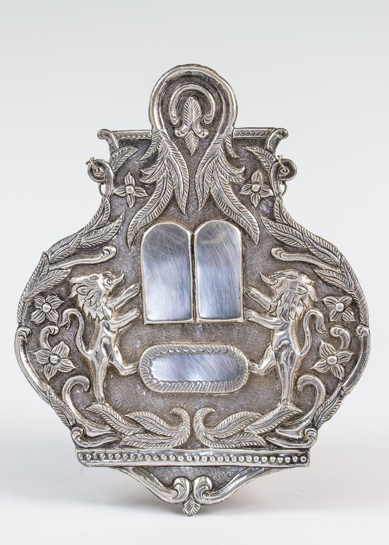 A SILVER TORAH SHIELD. American, modern. Hand chased in