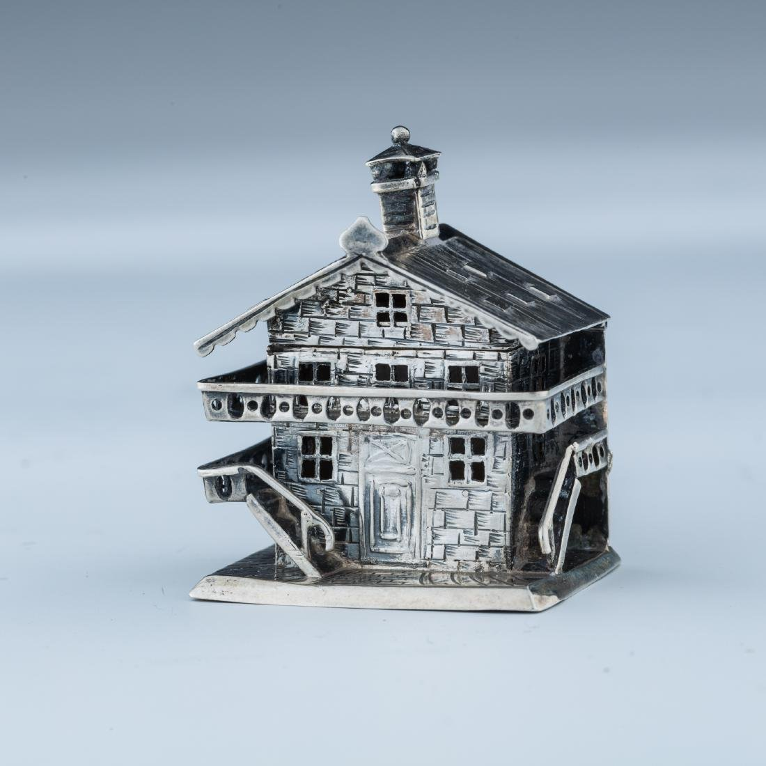 A SILVER HOUSE SHAPED SPICE CONTAINER. Continental,