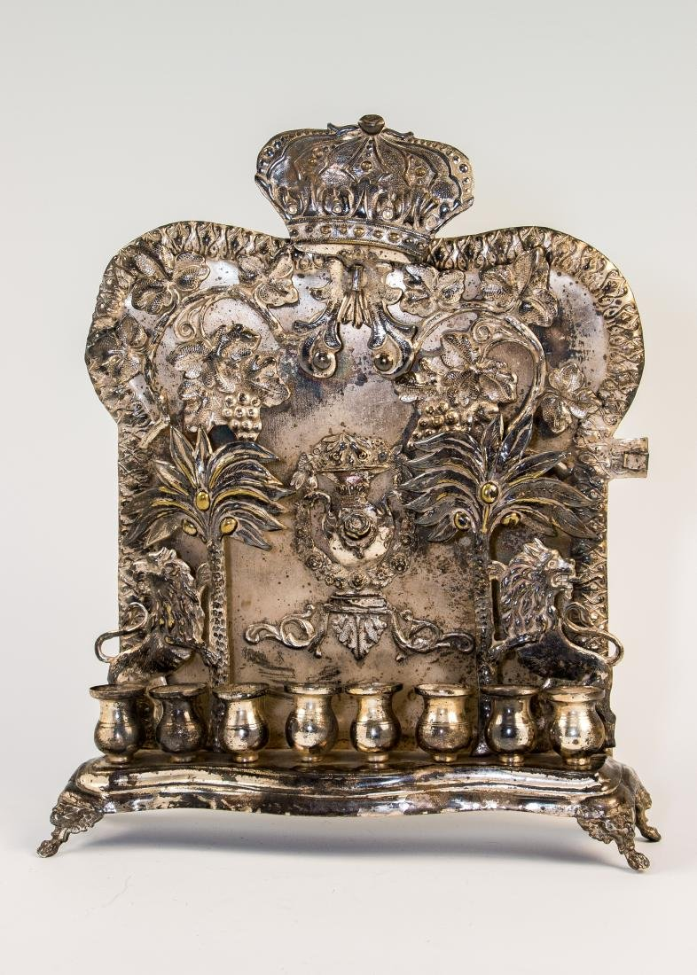 A LARGE HANUKKAH LAMP. Warsaw, c. 1890. On four claw