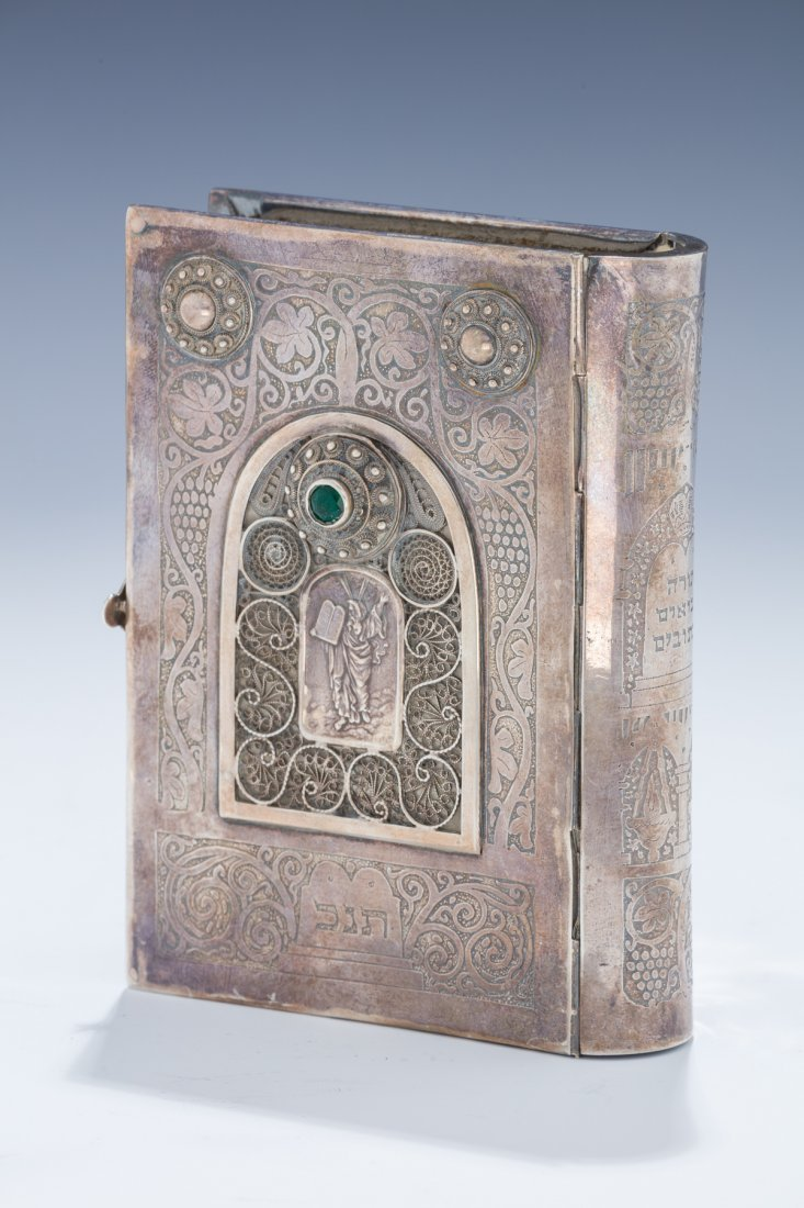 A STERLING SILVER BINDING WITH ORIGINAL TANAKH BY