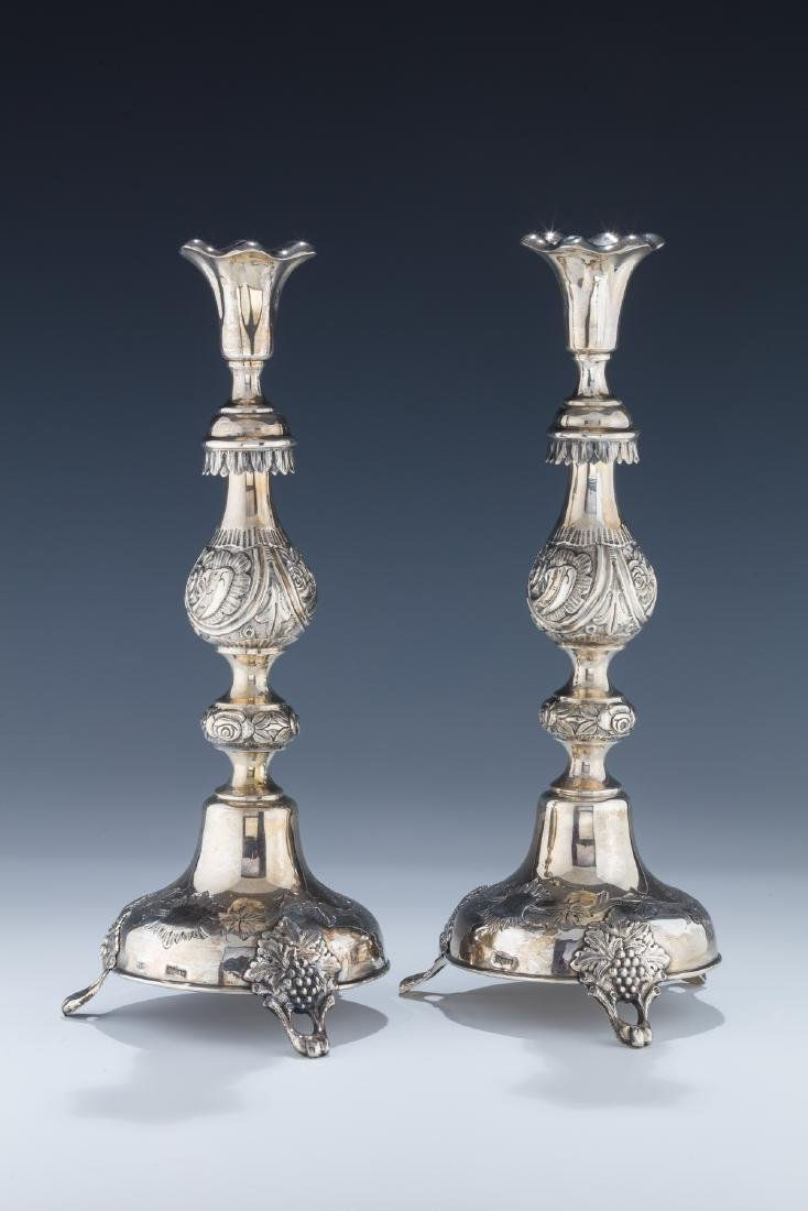 A PAIR OF SILVER CANDLESTICKS BY SHMUEL SKARLAT.