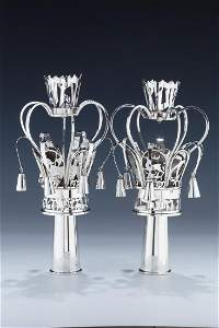 A PAIR OF HAND MADE STERLING SILVER TORAH FINIALS.