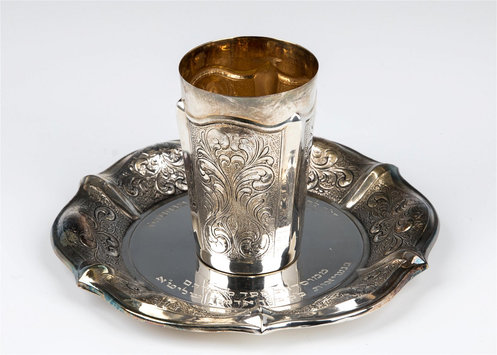 A STERLING SILVER KIDDUSH CUP WITH UNDERPLATE. Probably