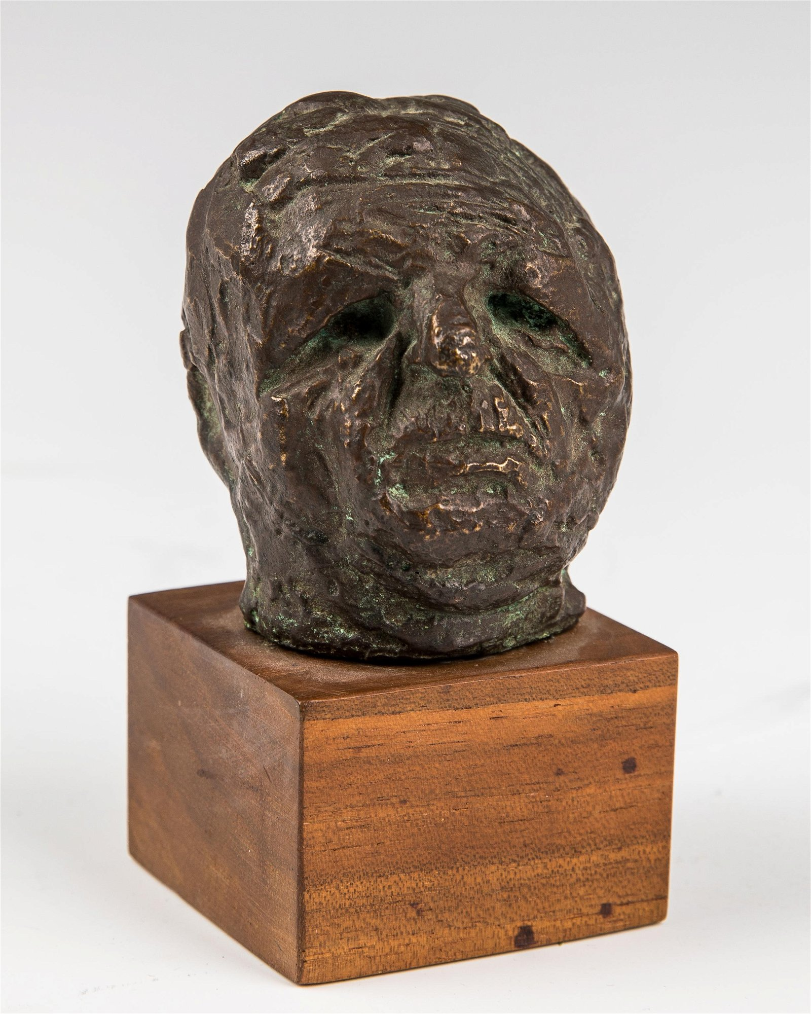 A BRONZE SCULPTURE OF A HEAD BY JAMES KEARNS. American,