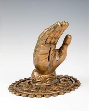 . A LARGE BRASS CHARITY RECEPTION HAND. In the style