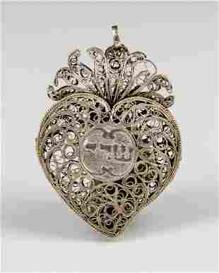 . A SILVER FILIGREE AMULET. Probably Italy. In heart