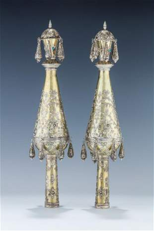 A PAIR OF GILDED SILVER TORAH FINIALS Probably Israel