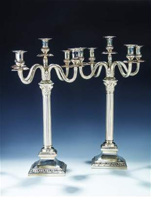A MONUMENTAL PAIR OF SILVER FIVE LIGHT CANDELABRAS BY