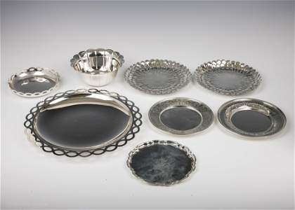 38. A GROUP OF EIGHT STERLING SILVER DISHES BY TIFFANY