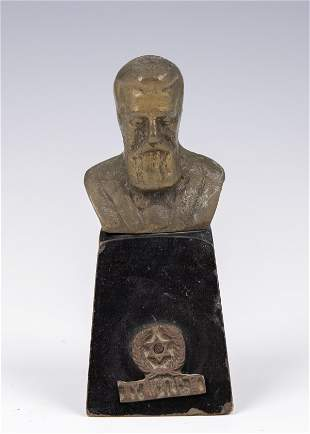 . A BRASS BUST OF DR. THEODOR HERZL. On a wood base