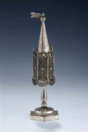 A LARGE SILVER SPICE CONTAINER
