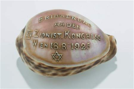 A CARVED COWRY SHELL COMMORATING THE 14TH ZIONIST