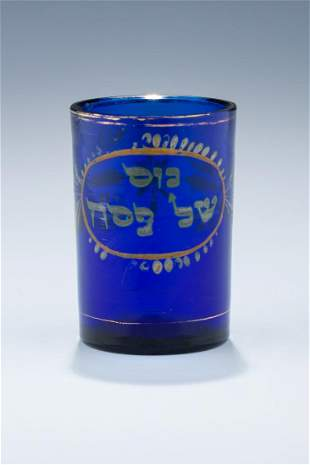 A BLUE GLASS PASSOVER BEAKER