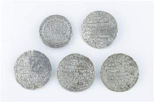 A GROUP OF FIVE CIRCULAR SILVER AMULETS