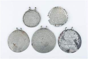 A GROUP OF FIVE LARGE CIRCULAR AMULETS