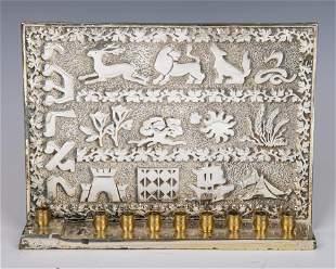 A WHITE METAL HANUKKAH LAMP