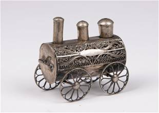 A SILVER LOCOMOTIVE SHAPED SPICE CONTAINER