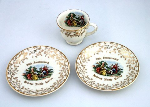 2: A SMALL PORCELIN TEA CUP AND MATCHING PLATES BY HOME