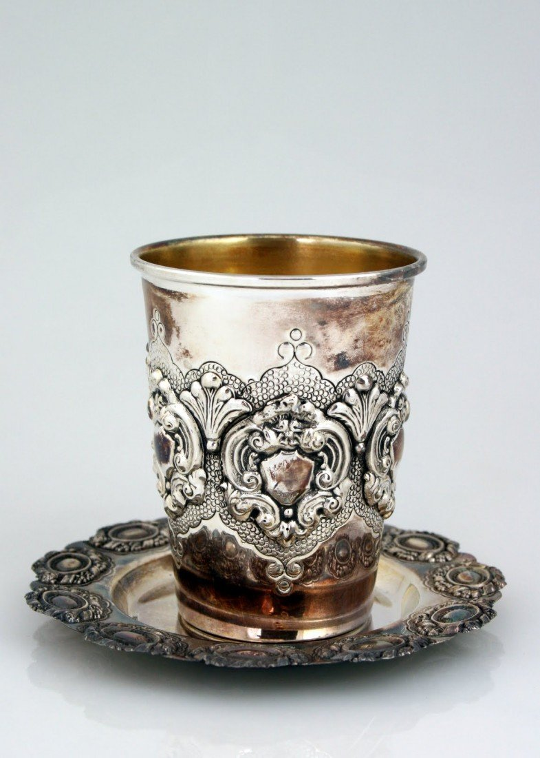 16: A STERLING SILVER KIDDUSH BEAKER WITH UNDER DISH. I
