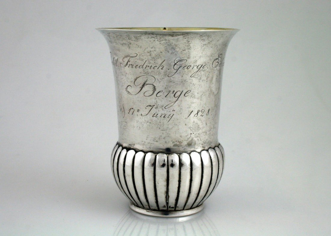 32: A LARGE SILVER CUP. 1828. In classical shape.