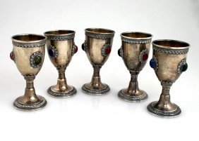A SET OF FIVE STERLING SILVER KIDDUSH GOBLETS. Isra