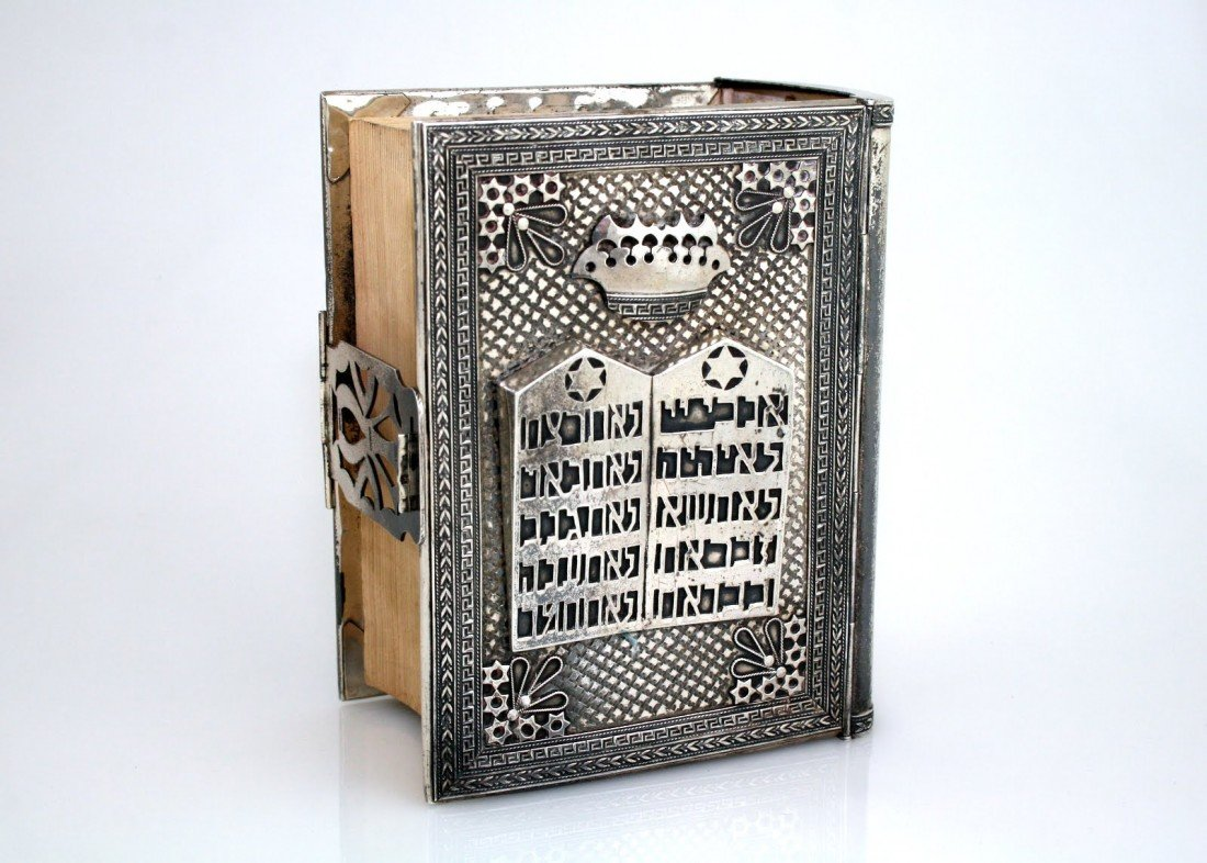 65: A STERLING SILVER BINDING WITH ORIGINAL BIBLE. Isra